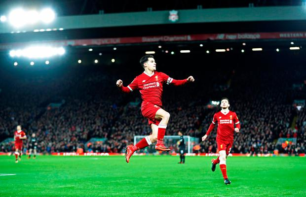 Liverpool's Philippe Coutinho celebrates scoring their first goal. Photo: REUTERS