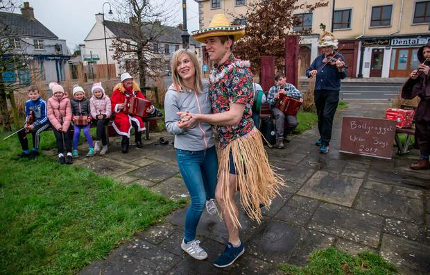 Maria Doyle from Wexford dances with Mark Stanton of the Ballyragget Wren Boys in the Co Kilkenny village, where the Wren is also celebrated Photo: Pat Moore