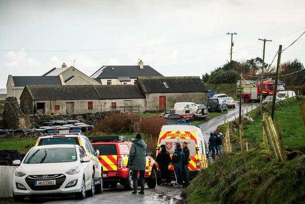 Locals gather at Carrowniskey, Louisburgh, Co Mayo, where two men lost their lives in a Christmas morning tragedy. Picture: Keith Heneghan