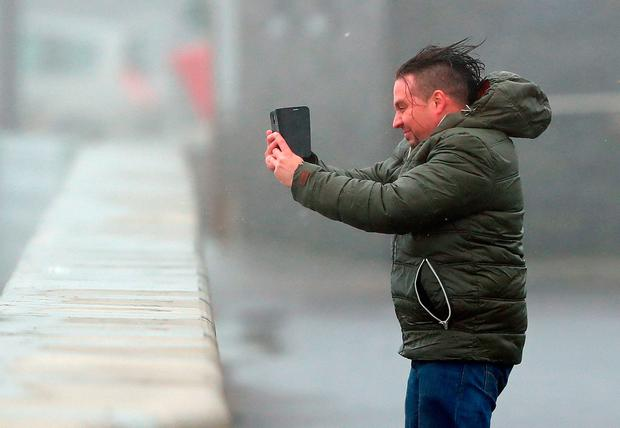 A man takes a selfie in the teeth of the wind at Lahinch in Co Clare during Ophelia's rampage. Photo: PA