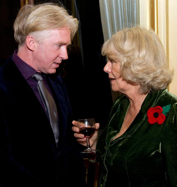Hat designer Phillip Treacy with the Duchess of Cornwall Picture: PA