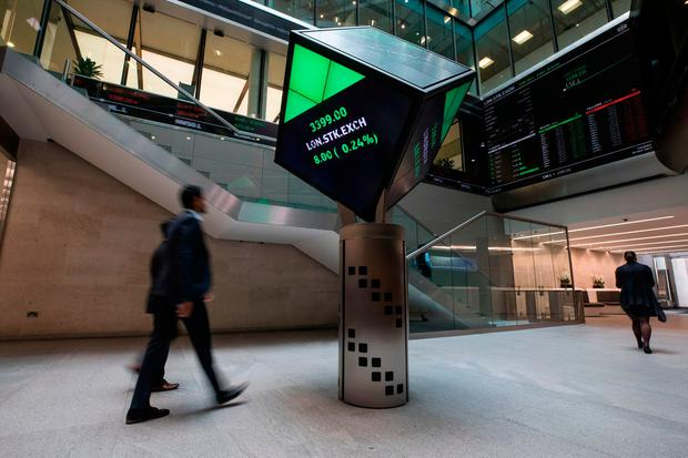 FTSE-100 firms listed on the London Stock Exchange include Irish companies like CRH and DCC. Photo: Simon Dawson/Bloomberg