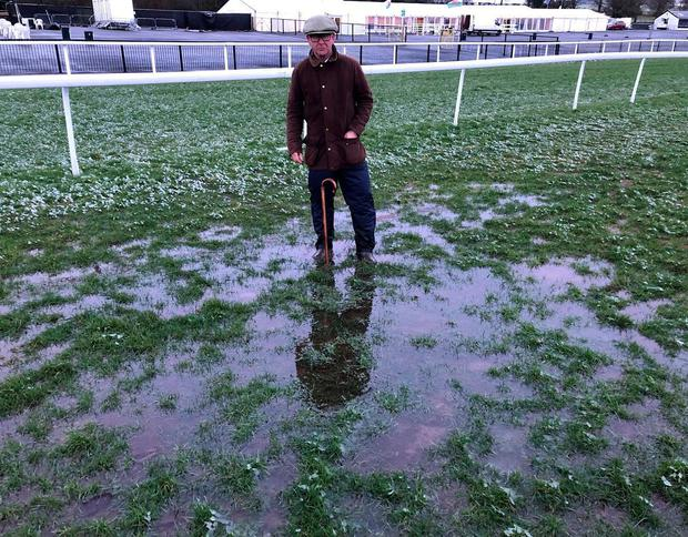 Officials at Chepstow show the full extent of the rainfall at the course which has caused the Welsh Grand National to be rescheduled from yesterday to January 6