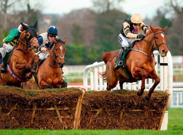 Meri Devie (right) on her way to winning at last year's Leopardstown Christmas festival and will be aiming to score again at Limerick today. Photo: Seb Daly/Sportsfile