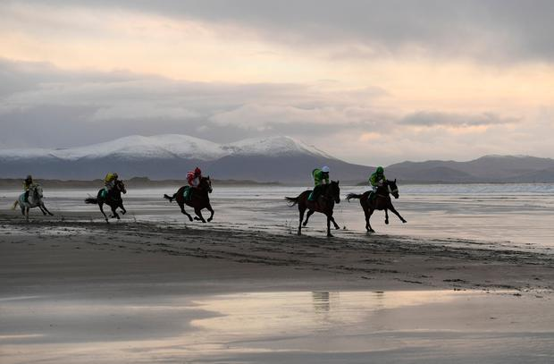 Runners and riders participate in the Christmas Ballyheigue beach horse races in the County Kerry village of Ballyheigue. REUTERS/Clodagh Kilcoyne