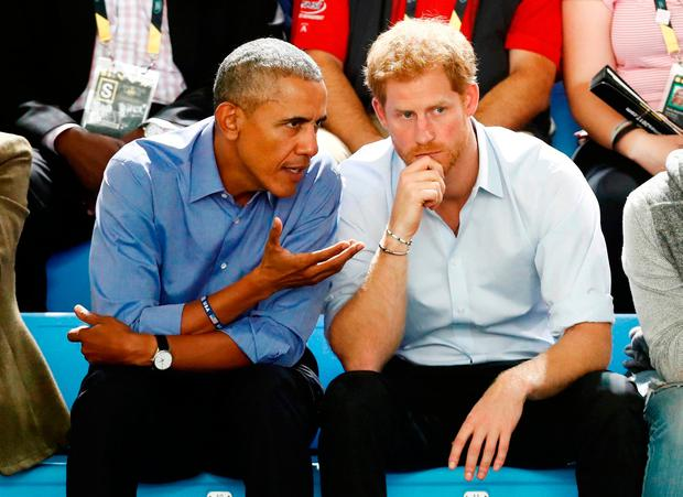 Britain's Prince Harry, right, and former US president Barack Obama watch a wheelchair basketball event in Toronto. Photo: Reuters