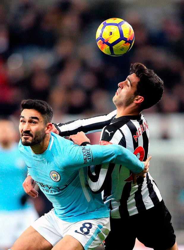 Manchester City's Ilkay Gundogan (left) and Newcastle United's Mikel Merino battle for the ball during the Premier League match at St James' Park. Photo: Owen Humphreys/PA