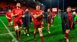 Munster payers, led by captain Peter O'Mahony, leave the pitch after defeat to Leinster