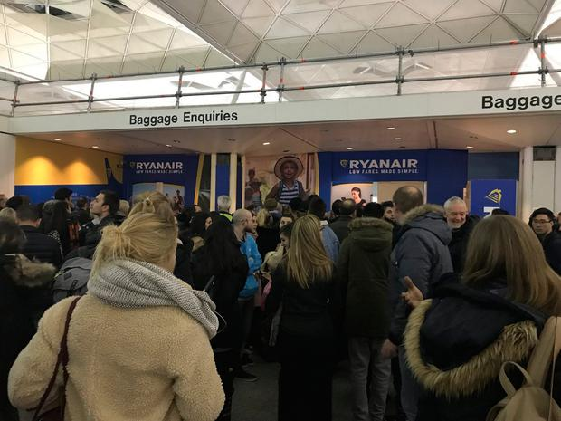 Passengers at Stansted Airport where hundreds of people had to rebook flights cancelled due to bad weather. Photo: Sophia Sleigh/ Press Association Images