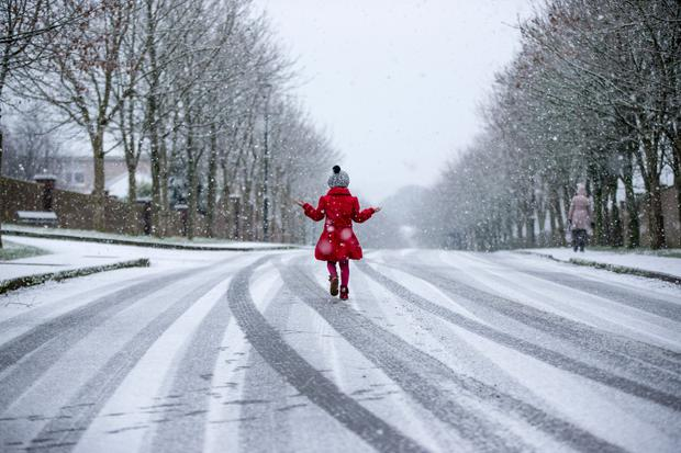 A young girl walks in the snow in Mallow, Co Cork just after Christmas