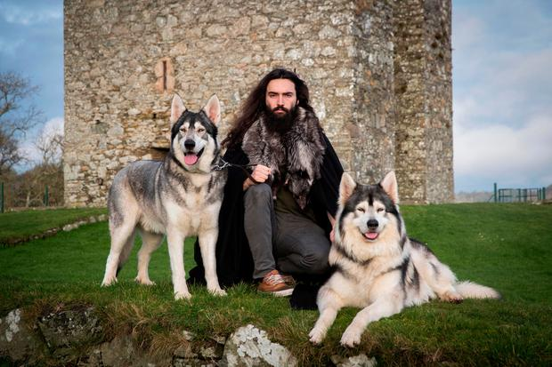 William Mulhall, of Direwolf Tours in front of Audley's Castle, in Co Down, with Thor (left) and Odin Photo: Liam McBurney/PA Wire