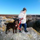 Kuba Wolanin (8) from Saggart takes a winter walk with his dog Toby at Kippure, Co Wicklow