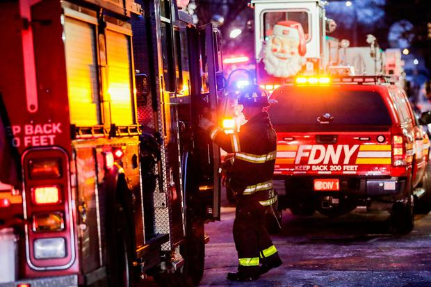 Fire Department of New York (FDNY) personnel work on the scene of an apartment fire in Bronx in New York, U.S., December 29, 2017. REUTERS/Eduardo Munoz