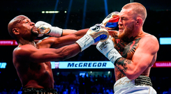 Conor McGregor and Floyd Mayweather trade punches during their fight in Las Vegas in August. Photo: Stephen McCarthy/Sportsfile