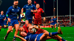 Simon Zebo fails to prevent Jordan Larmour from scoring his stunning try in Leinster's victory over Munster. Photo: Ramsey Cardy/Sportsfile