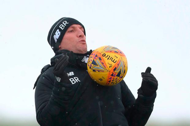 Brendan Rodgers is well wrapped up against the cold as he practises his ball skills during training at Lennoxtown yesterday. Photo: Getty Images