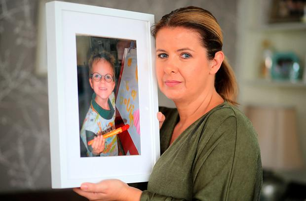 Maria Coyne with a pictured of Gavin (10), who died in a UK hospital waiting for a transplant