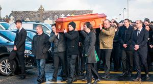 The coffin of Declan Davitt is carried by mourners at Killeen, Louisburgh, Co Mayo, yesterday. Photo: Keith Heneghan