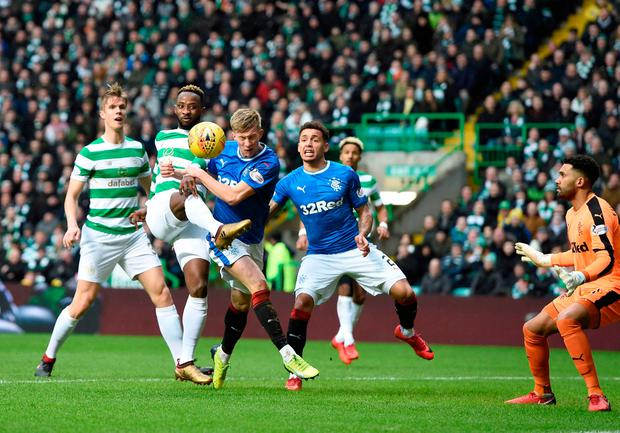 Celtic's Moussa Dembele tries to get a shot on goal with Ross McCrorie challenging