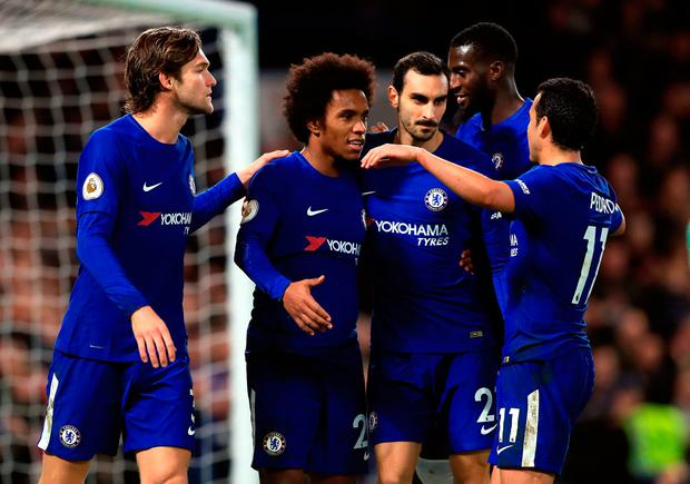 Chelsea's Willian celebrates scoring his side's fourth