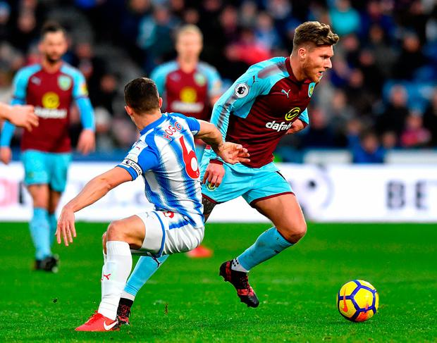 Burnley's Jeff Hendrick (right) and Huddersfield Town's Jonathan Hogg