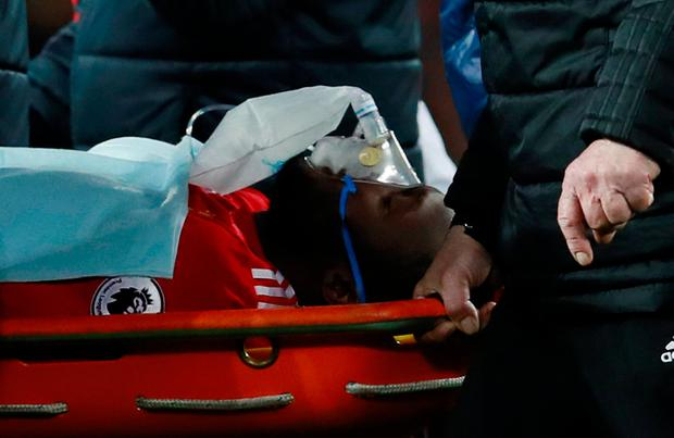 Manchester United's Romelu Lukaku is stretchered off after sustaining a head injury