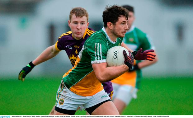 Daithí Brady of Offaly in action against Mick Furlong of Wexford