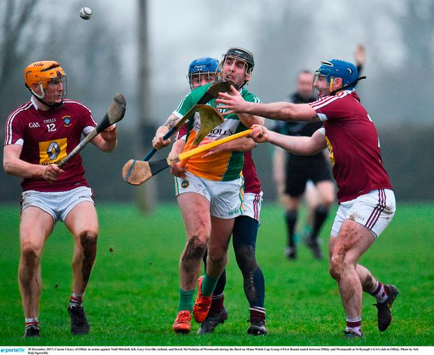 Ciarán Cleary of Offaly in action against Niall Mitchell, left, Gary Greville, behind, and Derek McNicholas of Westmeath