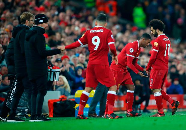 Mohamed Salah of Liverpool leaves the pitch to make way for Georginio Wijnaldum
