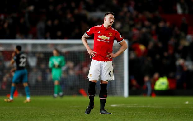 Manchester United's Phil Jones looks dejected after the match Action Images via Reuters/Jason Cairnduff