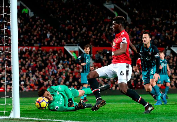 Paul Pogba pokes the ball over the line before seeing what he thought was the lead goal for Manchester United ruled out for offside. Photo: PA Wire