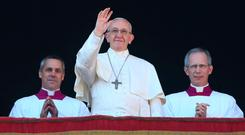 Pope Francis waves as he leads the