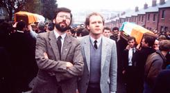 THE DIRTY WAR: Gerry Adams and Martin McGuinness at an IRA funeral in 1987
