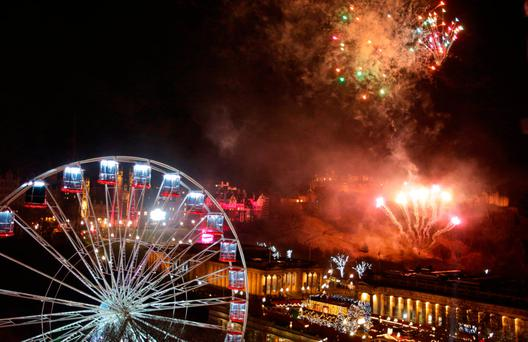Fireworks light up the sky in Edinburgh during the Hogmanay New Year celebrations. David Cheskin  PA Wire