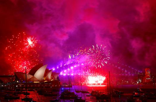 Fireworks light up the Sydney Harbour Bridge and Sydney Opera House as part of new year celebrations Photo: REUTERS/David Gray