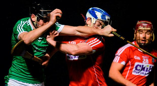 Limerick's Diarmaid Byrnes collides with Cork's Sean O'Donoghue. Photo: Eóin Noonan/Sportsfile