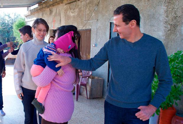 Syria's President Bashar al-Assad and wife Asma, left, in Homs Photo: Syrian Presidency Facebook page via AP