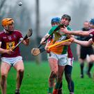 Offaly's Ciarán Cleary evades Westmeath trio Niall Mitchell (left), Gary Greville (behind), and Derek McNicholas. Photo: Seb Daly/Sportsfile