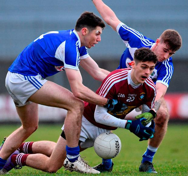 Westmeath's Ciaran Shanley loses control of the ball under pressure from Laois's Ruaidhrí Fennell (left) and Trevor Collins during Saturday's Bord na Móna O'Byrne Cup game at TEG Cusack Park. Photo: Ramsey Cardy/Sportsfile