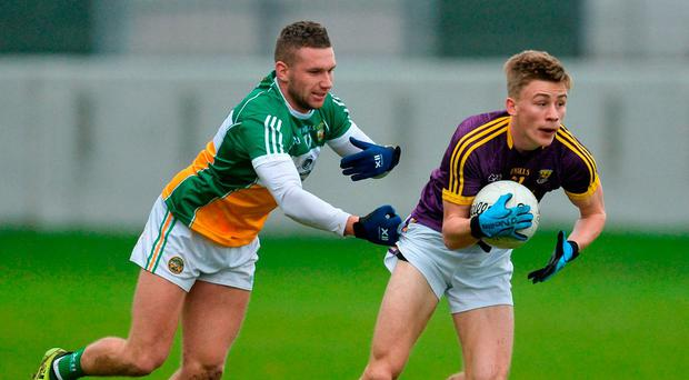 Offaly's Anton Sullivan attempts to hold on to Wexford's Martin O'Connor during Saturday's O'Byrne Cup clash at Bord na Móna O'Connor Park. Photo by Piaras Ó Mídheach/Sportsfile