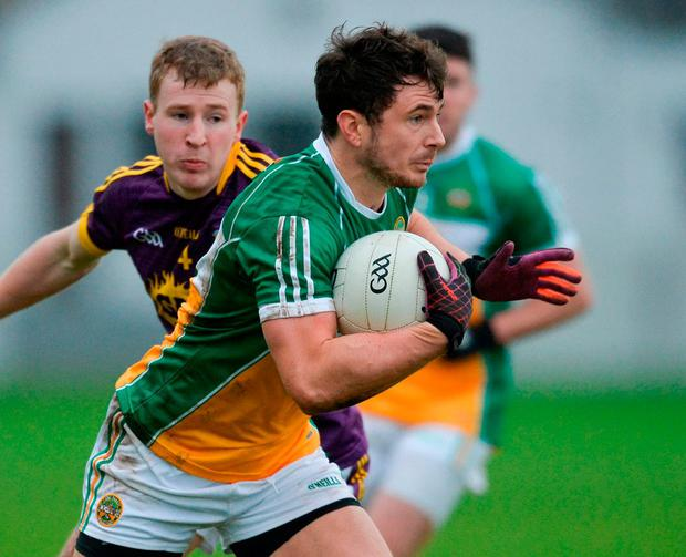 Offaly's Daithí Brady in action against Wexford's Mick Furlong. Photo: Piaras Ó Mídheach/Sportsfile