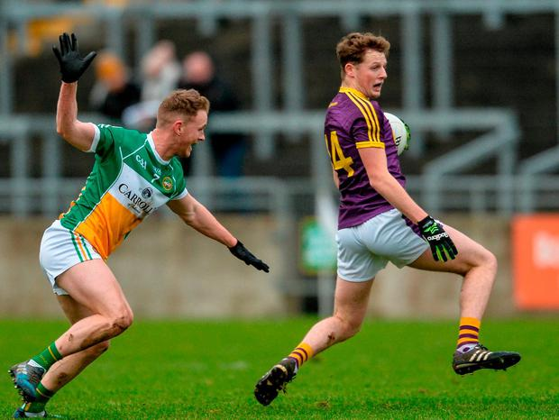Wexford's Mark Rossiter in action against Offaly's Declan Hogan. Photo: Piaras Ó Mídheach/Sportsfile