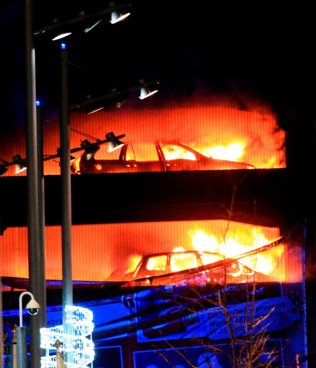 Vehicles burn during a blaze at a multi-storey car park at the Echo Arena on Liverpool's waterfront. Peter Byrne/PA Wire