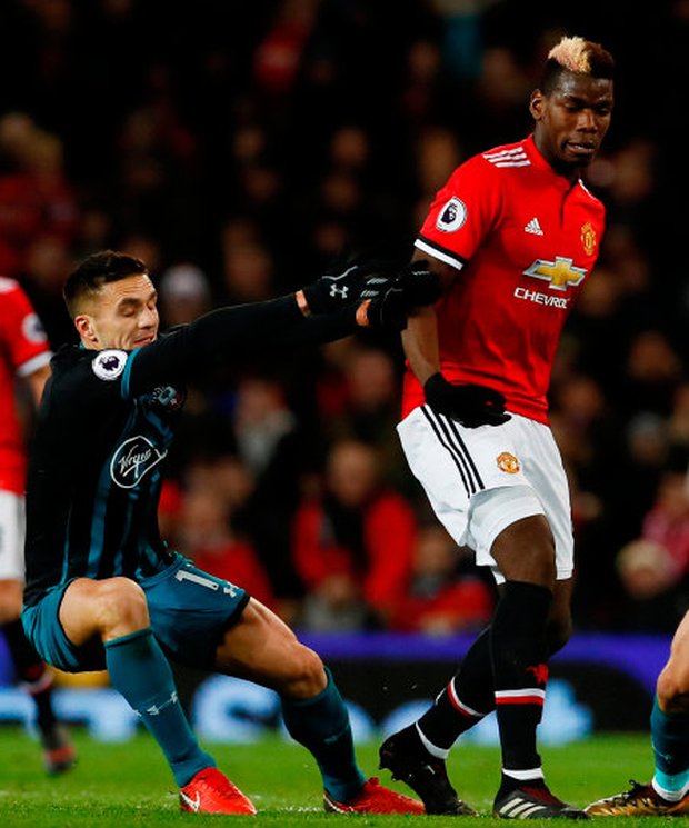 Manchester United's Paul Pogba brushes off Southampton's Dusan Tadic. The midfielder wants more from United