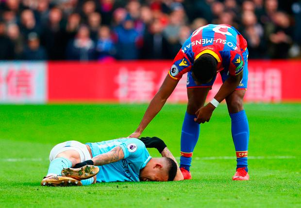 Timothy Fosu-Mensah of Crystal Paalce stands over an injured Gabriel Jesus of Manchester City Photo: Getty