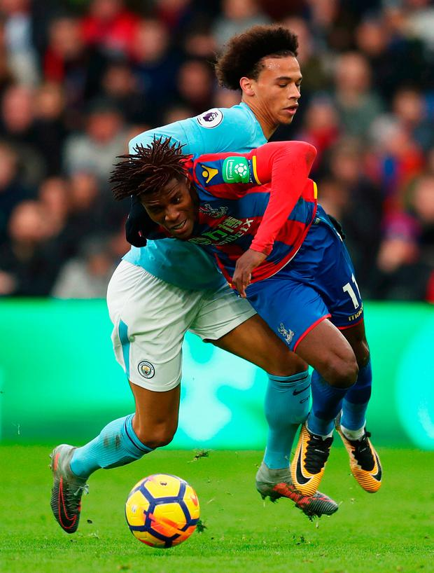 Wilfried Zaha of Crystal Palace tangles with Leroy Sane Photo: Getty
