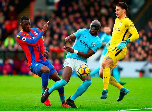 Christian Benteke of Crystal Palace is foiled by Eliaquim Mangala and Ederson of Manchester City Photo: Getty