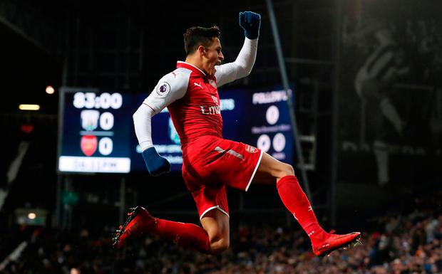 Arsenal's Alexis Sanchez celebrates after his side's first goal Photo: PA