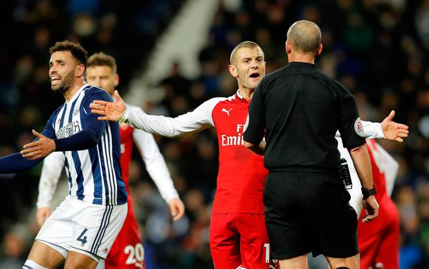 Arsenal's Jack Wilshere confronts referee Mike Dean Photo: Reuters