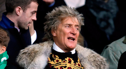 Rod Stewart sporting his new jumper at Celtic Park Photo: Reuters